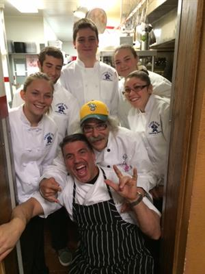 Mark Estee, Charlie Abowd, and culinary students