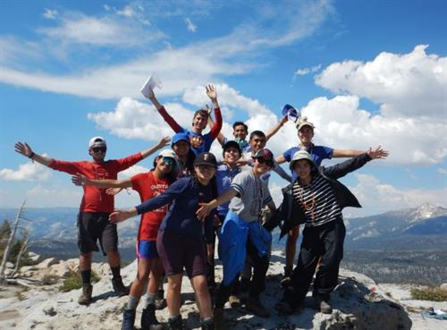Celebration at the summit during a backpacking trip in Yosemite