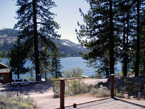 View of Donner Lake and 8,000 foot mountains as seen from deck, living, dining and kitchen.