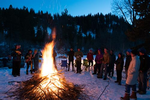 Winter bonfire and hot cocoa gathering