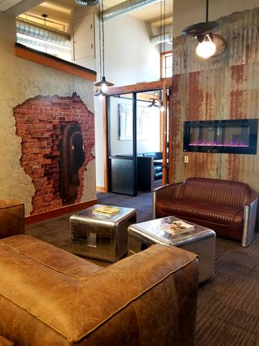 Luxury Leather Sofa and Chairs, Fireplace, Mural by John Pugh