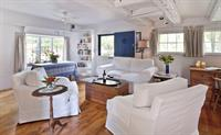 Living room with armchairs that swivel to face the couch or HDTV + Blu-Ray player