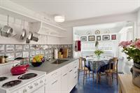 Well-equipped country kitchen with a sunny dining nook