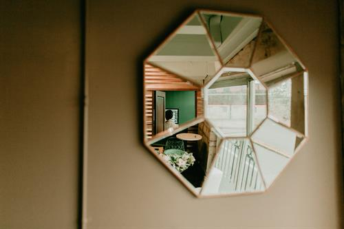 A stunning octagonal mirror reflects pieces of the studio.