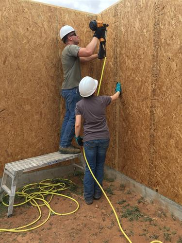Volunteers build walls
