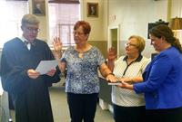 two new volunteers sworn in by Judge Pool and GAL attorney advocate