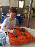 "A camper working on his paper maché ""cabezudo"" at our San Fermín Festival Program"