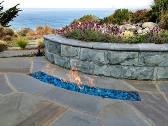 Curved in-ground firepit and seatwall.