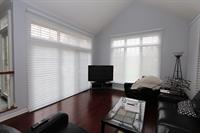 Hunter Douglas Silhouettes covering sliding glass door and large window