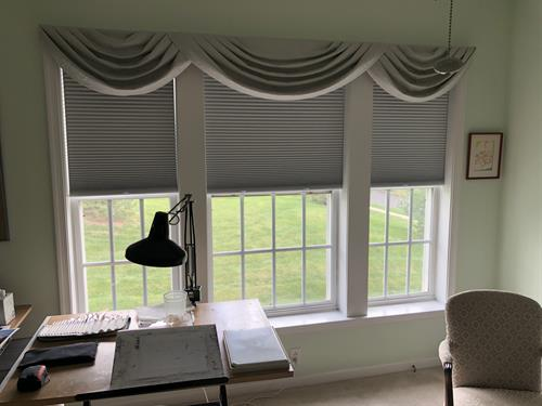 This artist's studio is complete with blackout cellular shades.