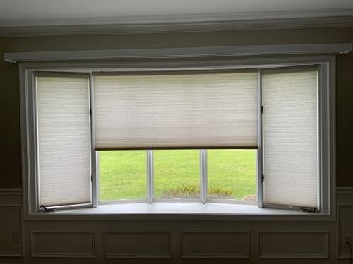 Not sure what to do with your big bow window? Cellular shades offer precise light and heat control.