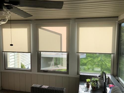 Cut the glare in your outdoor living space with the clean look and UV protection of solar shades.