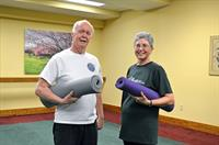 Residents Pat and Jim getting ready to enjoy a yoga class