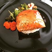 teriakyi glazed salmon over jasmine rice, roasted carrots and broccoli.