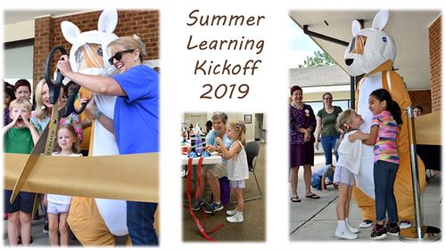Kit the Kangaroo cutting the ribbon and greeting children at the Summer Learning Kickoff