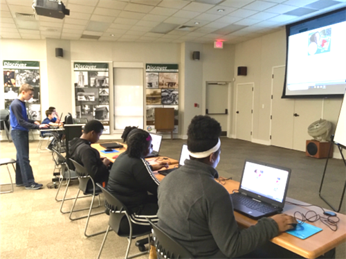 Teens learning to code programs at the Coding Event