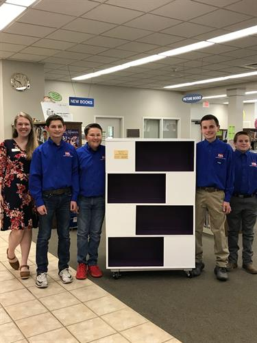 Students from Wayne School of Engineering donate a bookshelf they crafted in class.