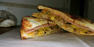 Queban grilled cheese sandwich.  Our play on the popular Cuban sandwich