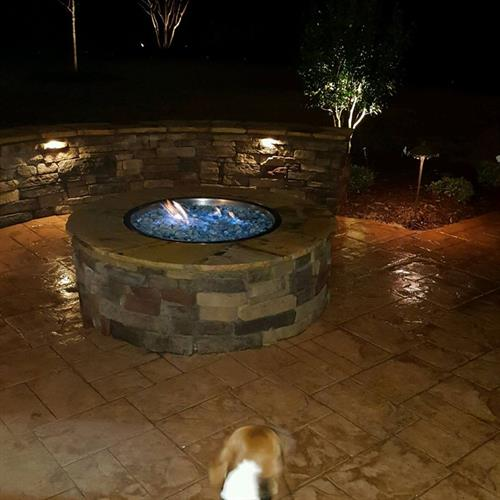 Custom Paver Patio and Paver sitting area, Custom Fire Pit whether it be gas or wood burning.