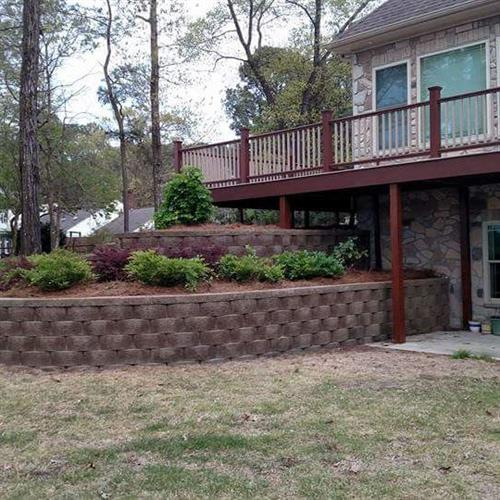 Custom Retaining Wall, Custom Landscape. Certified SRW installers by the National Concrete Masonry Association.