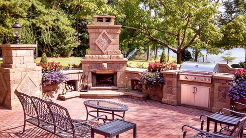Custom Outdoor Kitchen complete with grilling station, wash station and preparing station. Custom Fire Place are built with specific calculations to insure proper smoke drawl to blow away from the common sitting areas.