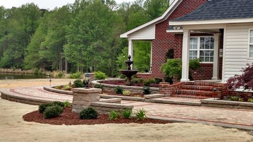 Custom Landscape and Custom Paver walkways that are built to last a lifetime.  We are the only Belgard Authorized contractor in our area.