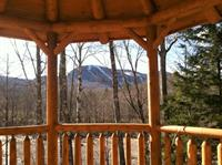 View of Sunday River Resort through a real log gazebo