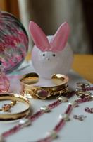 Hand blown Glass Bunnie surrounded by Harvest Gold Jewelry