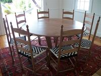 Shaker style trestle table with ladder-back dining chairs with unique diamond pattern seats.