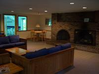 common room has large fireplace, WIFI couches & games
