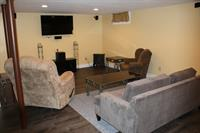 Finished Basement With Large Screen TV & Surround Sound. Front View