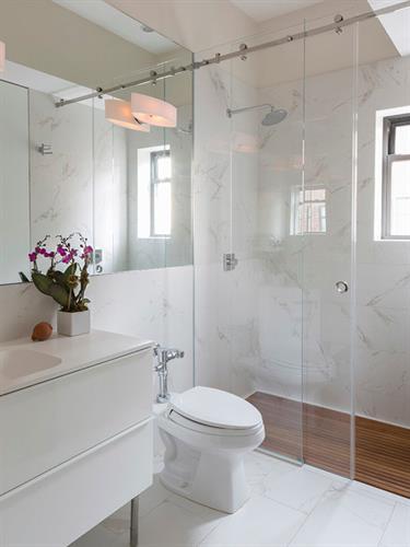 Bathroom with Sliding Barn Door Shower Enclosure