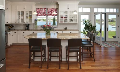 Kitchen with Glass Inset Cabinets & House Windows