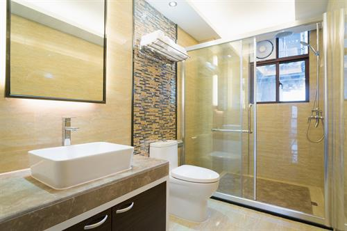 Bathroom with Framed Shower Enclosure & Vanity Mirrors