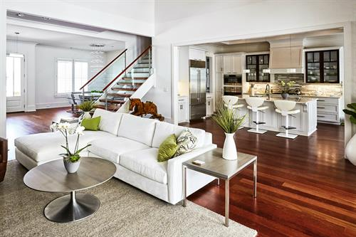 Living Room with Glass Staircase Rails & Kitchen with Glass Cabinet Insets