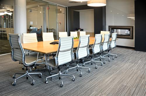 The conference room is outfitted with comfortable Herman Miller Eames chairs and plenty of technology for productive, formal meetings.