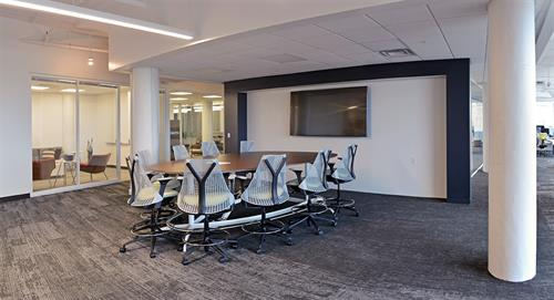 Collaborative meeting space featuring Herman Miller Exclave table and Sayl stools.
