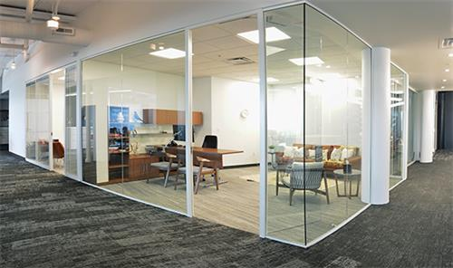Private office featuring Maars engineered glass walls, Geiger desk and task chair, along with classic Herman MIller Crosshatch chairs and DWR sofa.