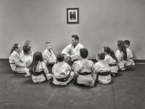 Sensei Kevin Downard having a discussion with our tournament students on a Sunday afternoon.