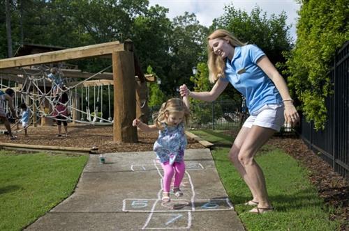 Hasentree members enjoy outside fun near the Adventure Playground!