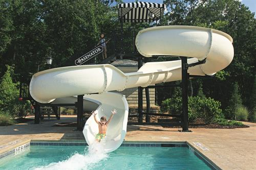 "Relax in one of 3 resort-style pools or take the plunge down our double-loop water slide, the ""Hasenator!"""