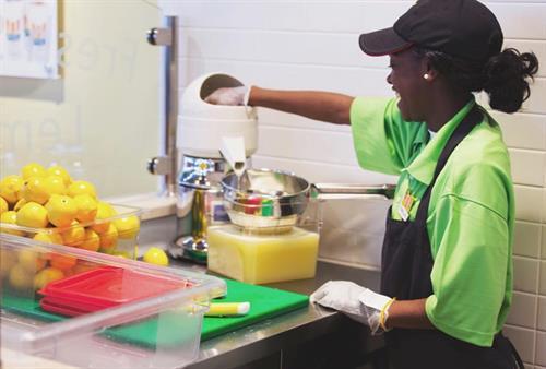 Staff squeezes lemons into lemonade daily
