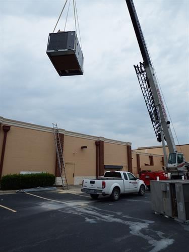 Craning a Unit to the roof during a replacement