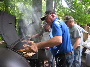 The Pitmasters, doing what they do best and our secret weapon!
