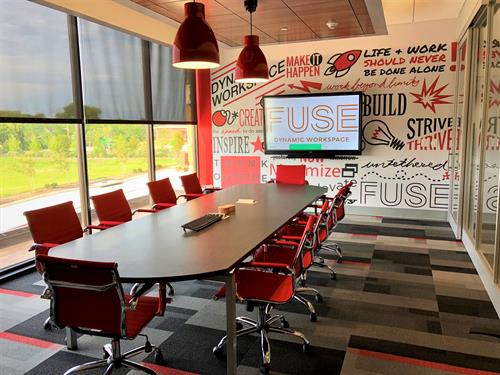 Spark Tank meeting room on second floor. Seats up to 16 people.