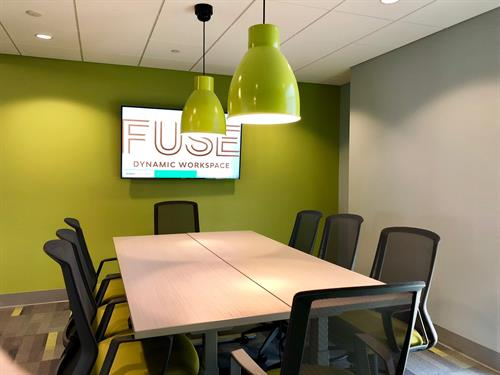 Incubator Meeting room on first floor. Adjustable conference tables with counter heigth chairs. Seats eight people.