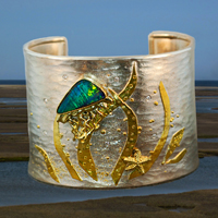 An undersea cuff bracelet in 22k gold, Argentium Silver, Opal and Diamonds