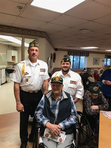 Commander Jasen Pomroy, Sr Vice Commander Ron Ramos, and WWII veteran Larry Philipson