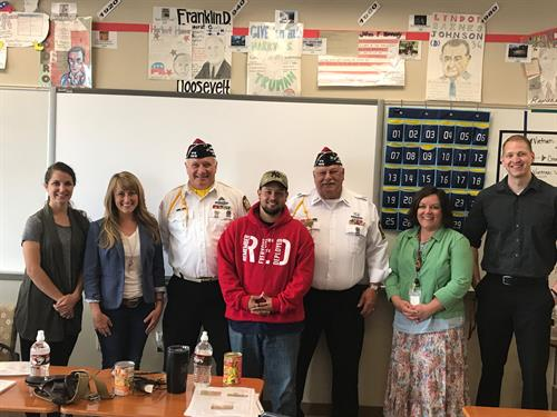 VFW members and Sr Vice Commander Ron Ramos with teachers of New Richmond High School during Veterans in the Classroom