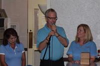 Scott McCaffrey announcing the WIMAH Golf Winners with Cathy Bannister (Rt) and Cathy Wilson (Lt)